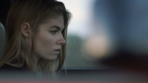The girl is sad for driving a car, a model of a hipster in the car, Melancholy