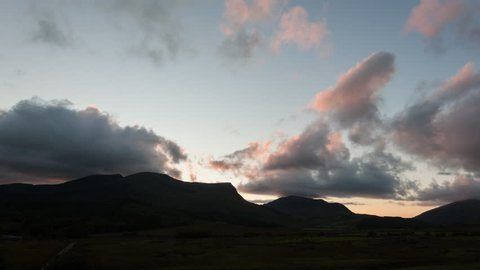 Sunset clouds over mountains in Snowdonia National Park, Wales.