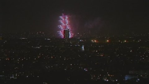 PARIS, FRANCE - JULY 14 2018: VHS effect over aerial still drone view of spectacular night fireworks at the Eiffel Tower with the occasion of National Holiday, also known as Bastille Day