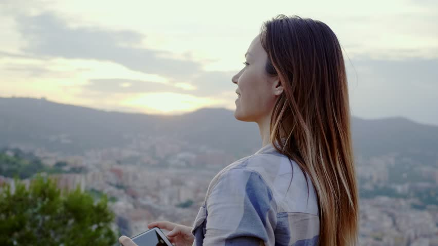 Beautiful woman enjoying Barcelona city view from Bunkers del Carmel, Spain | Shutterstock HD Video #1014885154