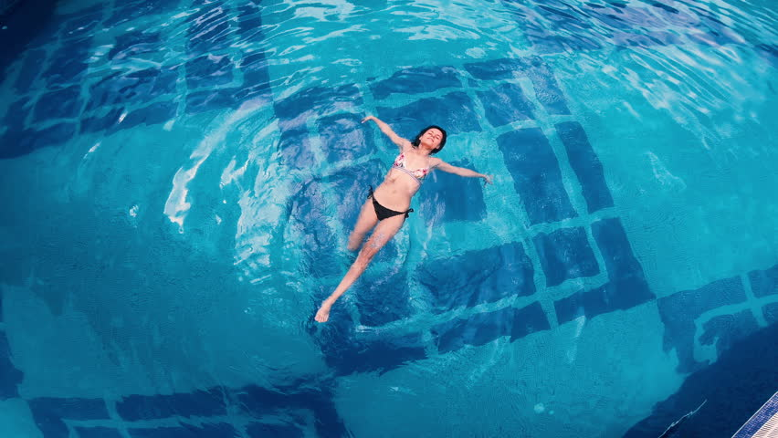 Aerial view of lying on water surface in big swimming pool | Shutterstock HD Video #1014940414