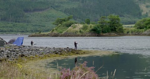 Anglers catching a fish in the Scottish Highlands on a grey day | 4K