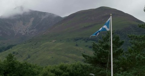 Scottish flag waving in the highlands in slow motion | 4K