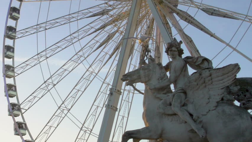 Pegasus Equestrian statue in front of Big Wheel at sunset, sightseeing in Paris