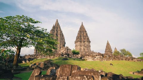 Prambanan temple and green lawn slide on sunny day