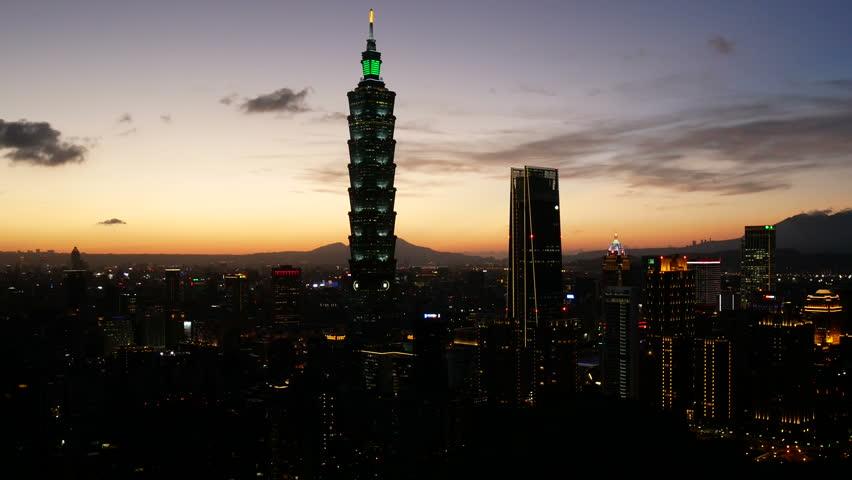 Cityscape of Taipei skyline during sunset twilight, Taiwan. | Shutterstock HD Video #1015029034