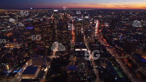 Aerial city connected through 5G. Wireless network, mobile technology concept, data communication, cloud computer, artificial intelligence, internet of things. Los Angeles skyline. Futuristic city.
