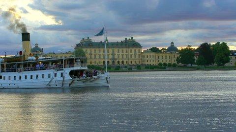 Drottningholm, Sweden - AUGUST 15, 2018: Steamboat trafficing Drottningholm Palace, Stockholm, Sweden.