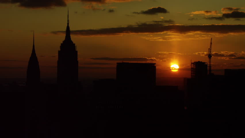 Aerial view of urban city at sunset. Shot of skyscrapers in New York City. Shot with a RED camera. 4k footage.