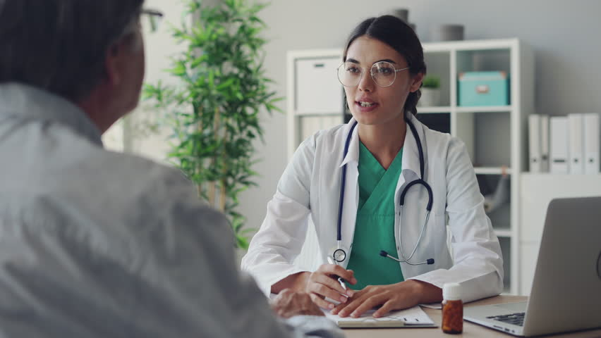 Doctor and patient are discussing at clinic | Shutterstock HD Video #1015147114