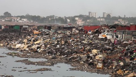 Ghana, West Africa - 2018: Scrap workers at Ghana's Agbogbloshie, the world's largest electronic waste site.