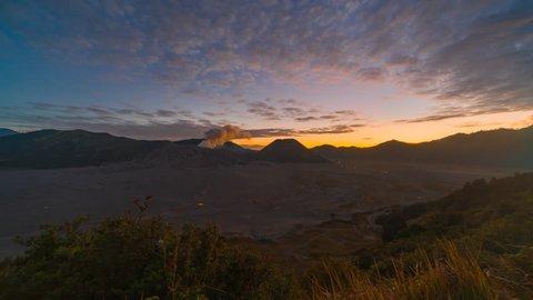 4K Time lapse of cloudy sunset over mountain range at Mount Bromo, Semeru, Tengger National Park, Indonesia. Reverse clip motion