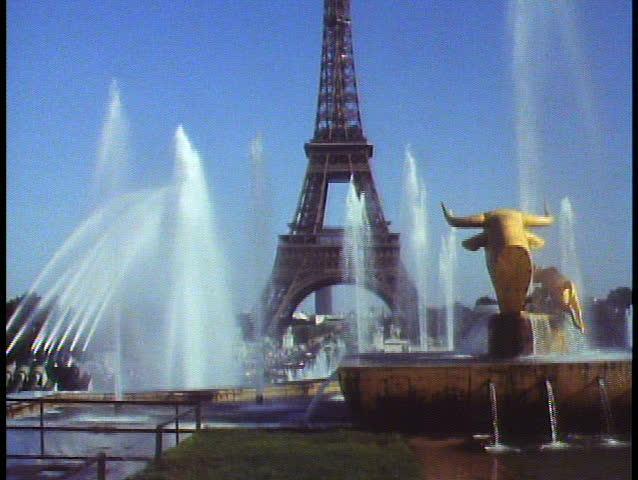 PARIS, FRANCE, 1988, The Eiffel Tower, fountain and golden bull, tilt up