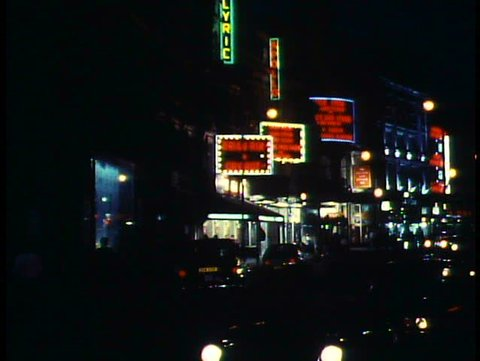 LONDON, ENGLAND, 1988, Shaftsbury Avenue at night, buses, theatre marquees