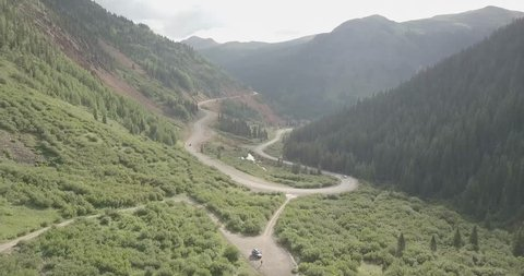 Flyover of a mountain valley hairpin turn in the road in the Rocky Mountains of southern Colorado