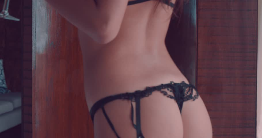Closeup body of fashion model indoors. Beauty brunette woman with attractive body in lace lingerie. Female ass in underwear. Closeup of naked girl
