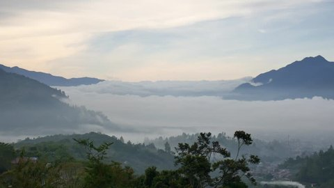 Lake Covered with Cloud and Mist View from High Hill in Lake Lut Tawar Takengon, Aceh, Indonesia