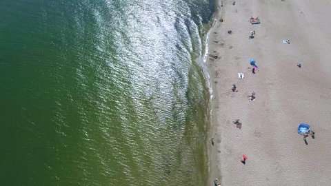 4k. Aerial vieon the sandy beach. The Baltic Sea city of Gdansk Poland. Tourists are sunning on a sandy beach in the open sun.