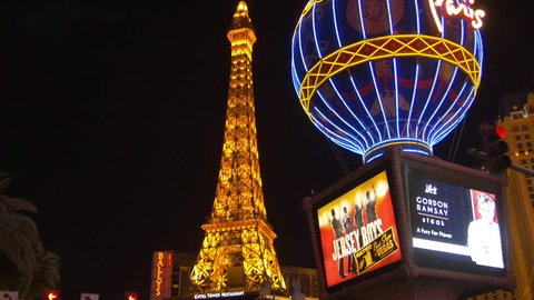 Las Vegas, United States - July, 2016: Paris Las Vegas Hotel with the Eiffel Tower replica seen at night on the Las Vegas Boulevard