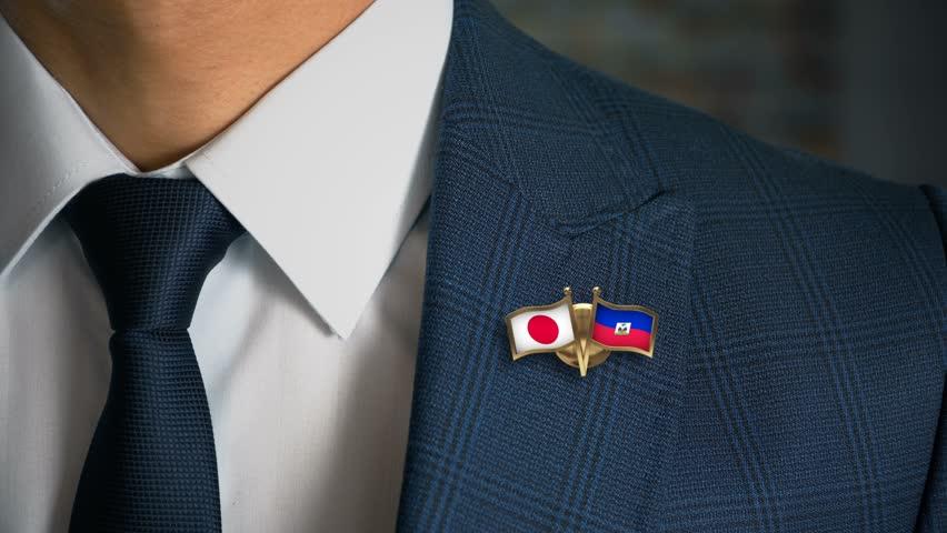 Businessman Walking Towards Camera With Friend Country Flags Pin Japan - Haiti