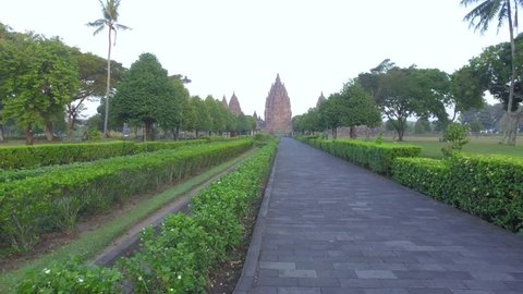 Hyperlapse of the morning view of Prambanan Temple main road with trees and greenery surrounds it located in in Yogyakarta & Central Java
