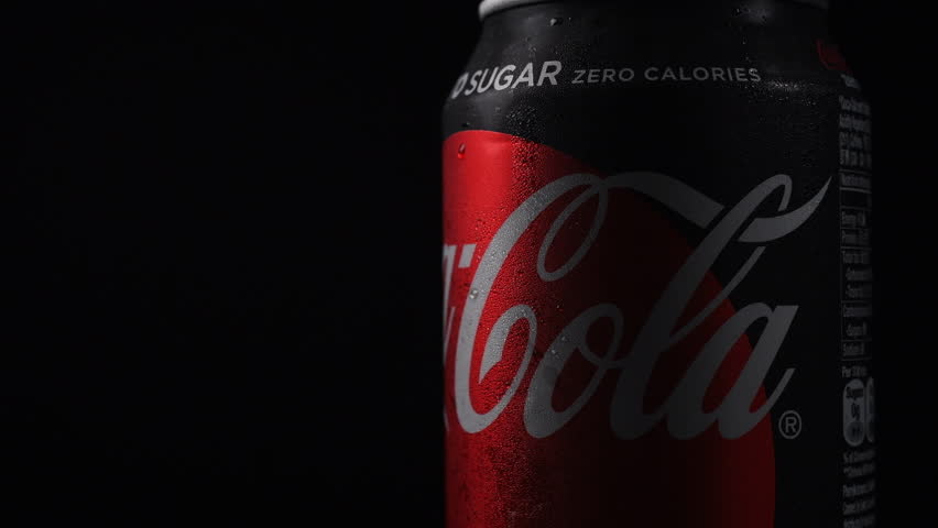 Hong Kong,21-August-2018,Coca-Cola zero sugar can rotating on black background. Coca-Cola is a carbonated soft drink produced by The Coca-Cola Company - American multinational beverage corporation.