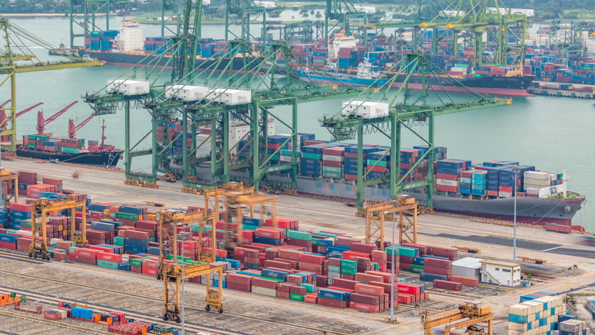 Commercial port of Singapore timelapse. Bird eye panoramic aerial view of busiest Asian cargo port with hundreds of ships loading export and import goods and thousands of containers in harbor