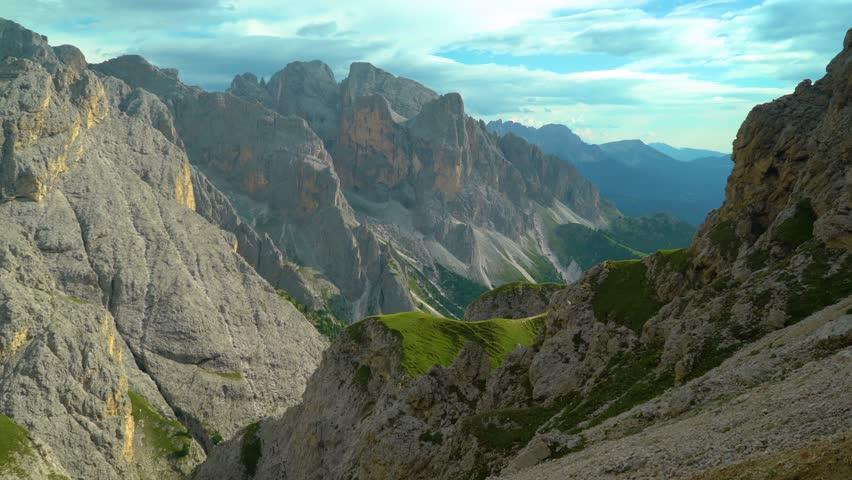 Beautifull Dolomites Landscape. Italian Dolomites Via Ferrata.  Climbing treckking hikeing outdoors activities in italian Dolomites Mountains. 4K Video. Cortina D Ampezoo Valley. Sunny meadow