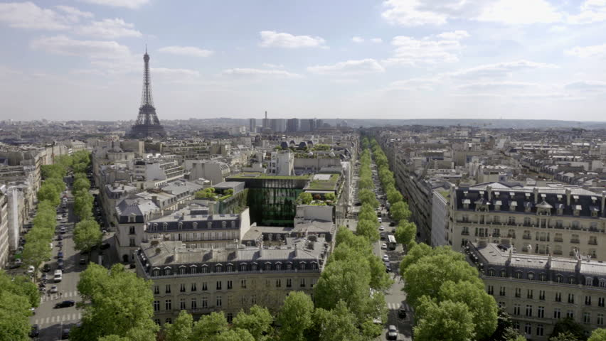 PARIS - MAY 3, 2018: panning across city from high view with Eiffel Tower and tree lined street of Champs de Mars in Paris France Europe. Paris is a top three tourist city in the world. | Shutterstock HD Video #1015324024