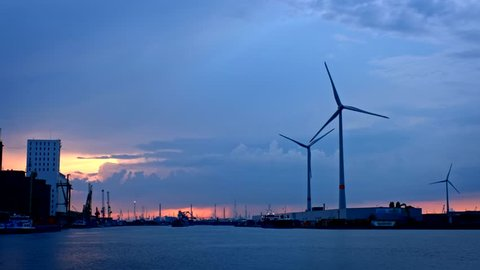 Wind turbines in Antwerp port in the evening. Antwerp, Belgium