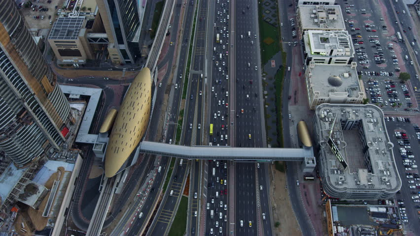Aerial view overhead Dubai junction Intersection Sheikh Zayed Road Skyscrapers desert traffic elevated Roads Dubai Metro Rail transport UAE RED WEAPON | Shutterstock HD Video #1015399024