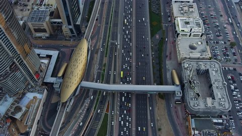 Aerial view overhead Dubai junction Intersection Sheikh Zayed Road Skyscrapers desert traffic elevated Roads Dubai Metro Rail transport UAE RED WEAPON