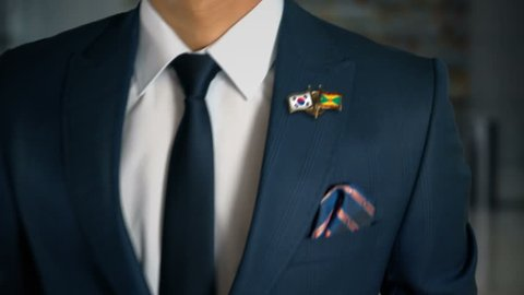 Businessman Walking Towards Camera With Friend Country Flags Pin South Korea - Grenada