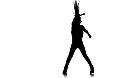 Baby dances to sit on the twine and raises her leg up. White background. Silhouette
