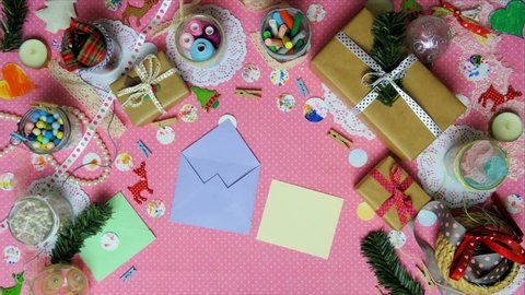 Top view stop motion on the theme of holiday with text Secret Santa emerging from particles
