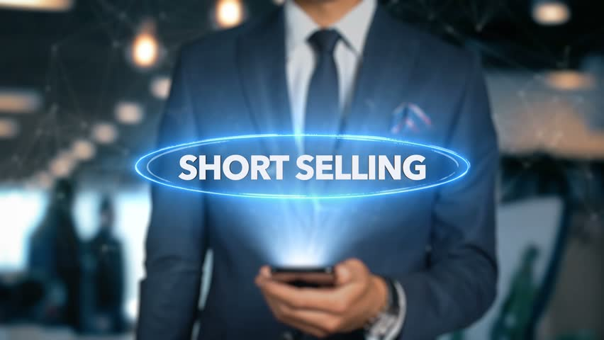 Businessman With Mobile Phone Opens Hologram HUD Interface and Touches Word - SHORT SELLING