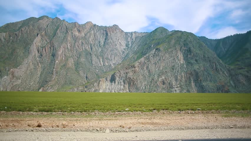 Scenic Panorama of Beautiful Moutains from the Driving Car