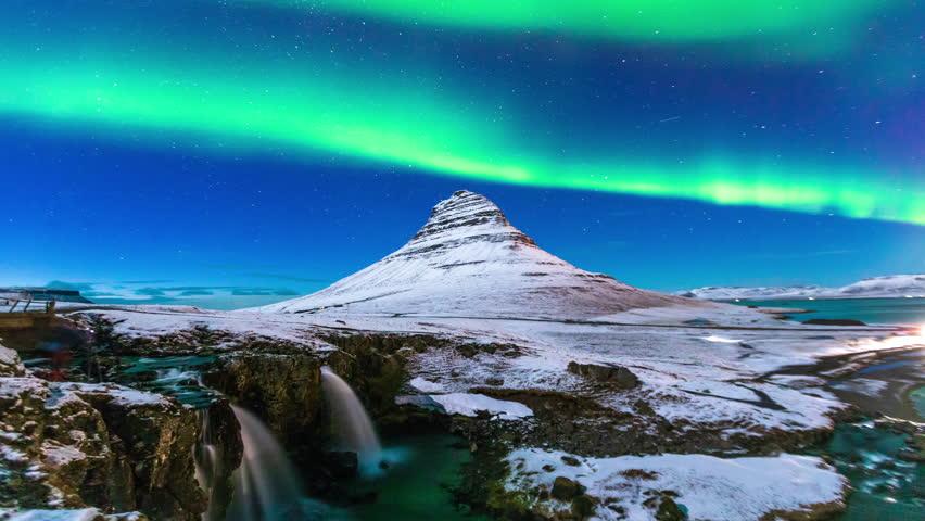 Aurora borealis above kirkjufell mountain in winter Iceland | Shutterstock HD Video #1015553074