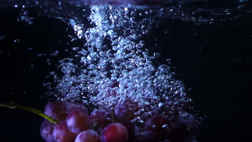 Grape pouring to water slow motion