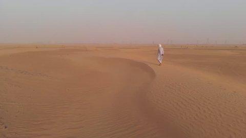 Tuareg man walking in a desert