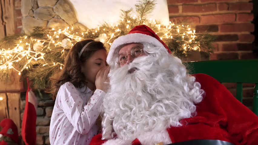 Girl whispering the hidden dreams for Santa Claus