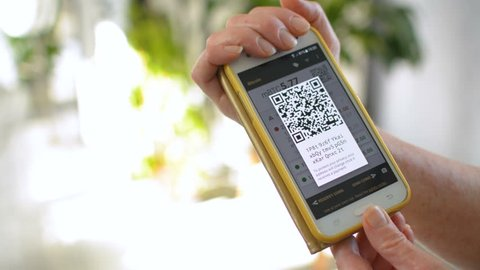Man and woman exchaning funds through peer-to-peer digital cryptocurrency Bitcoin, digital cash transaction concept