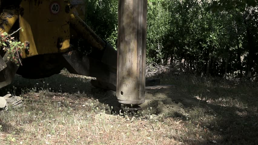 Construction drill auger working in the countryside