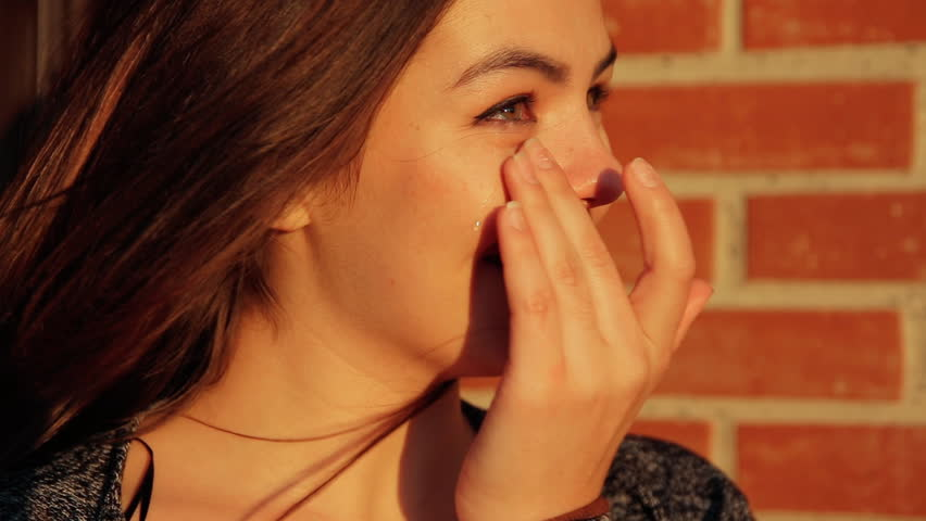 Portrait of a young woman crying with unexpected joy. | Shutterstock HD Video #1015655074
