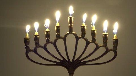 Jewish Hanukkah with burning candles in motion - judaica simbol for Hanukkah