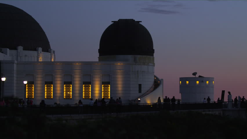 Shot of the Griffith Observatory in Los Angeles at night, with tourists exploring the tourist spot #1015660864
