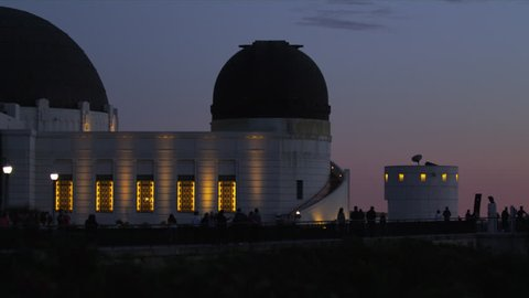 Shot of the Griffith Observatory in Los Angeles at night, with tourists exploring the tourist spot