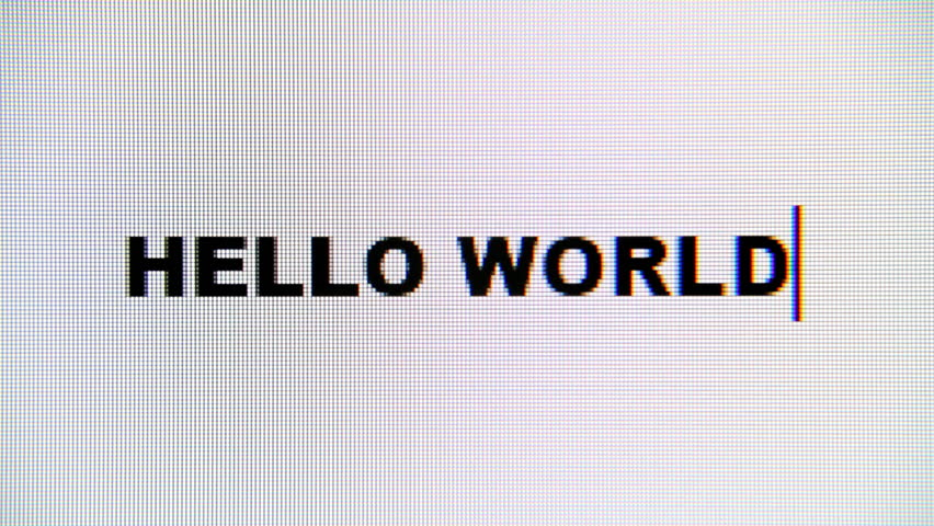 Typing the words Hello World on a computer monitor. Macro detail shot.  | Shutterstock HD Video #1015683334