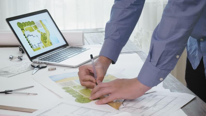 Landscape architect working on a backyard plan | Shutterstock HD Video #1015687744