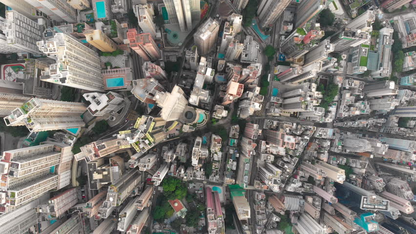 Aerial drone shot of congested building area of Hong Kong city and traffic | Shutterstock HD Video #1015702504